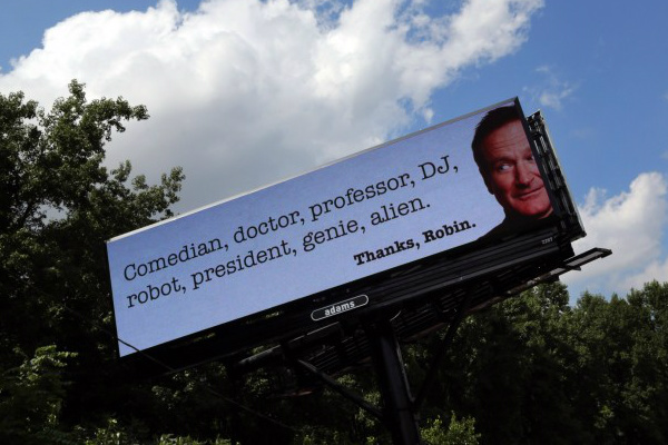 This is an image of a roadside billboard that memorializes Robin Williams after his death.