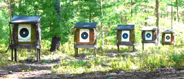 This is an image of an outdoor archery range in a wooded area.